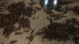 Black Coffee And Roasted Beans On Background Of Bagging