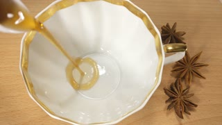 Pouring Tea In Vintage Cup
