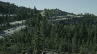 4K Aerial Flying over Forest and Highway to Lake Tahoe