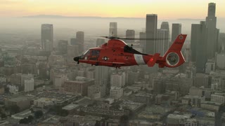 4K Aerial of Coast Guard Helicopter Flying next to Downtown Los Angeles