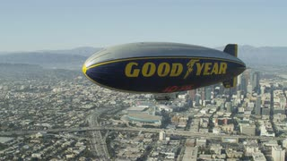 4K Aerial of Good Year Blimp flying over City