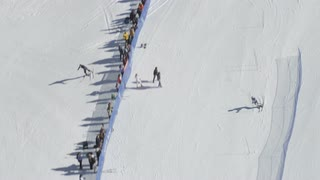4K Aerial of Skier Going down Snowy Mountain