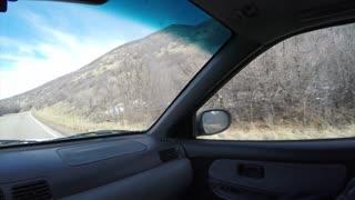 4K clip Driving down a mountain road passenger windowPOV
