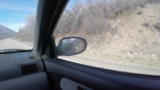 4K clip of driving down a mountain road passenger windowPOV