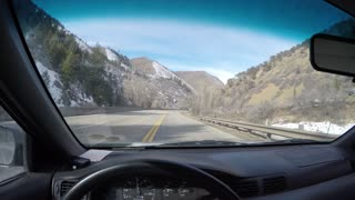 4K shot Driving down a mountain road POV