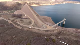 A beautiful aerial shot of a mountain reservoir and dam