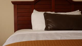 A beautiful interior dolly shot of hotel room bed