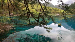 a blue water lake at jiuzhaigou valley national park in china tilting shot