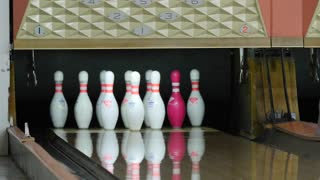 A bowling ball misses the pins at the bowling alley