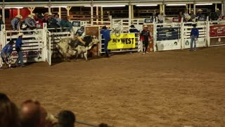 a bull rider at rodeo slow motion