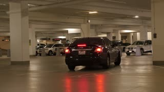 A car driving in a parking garage