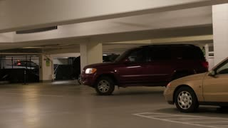 A car driving in parking garage