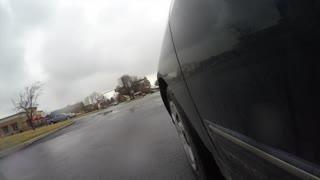 A car driving in Provo city Utah exterior low shot