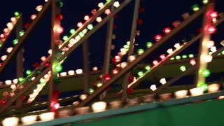 a carnival ride at night with flashing lights