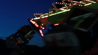 a carnival ride at night with the flashing lights
