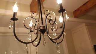 a chandelier in a kitchen dolly shot