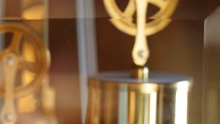 A closeup dolly shot of the pendulum on a grandfather clock