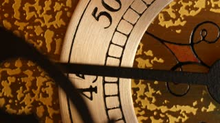 A closeup dolly shot of the second hand on a grandfather clock