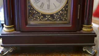A cool antique clocks hands rotating with time