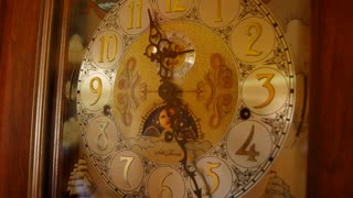 A cool old grandfather clock face in living room