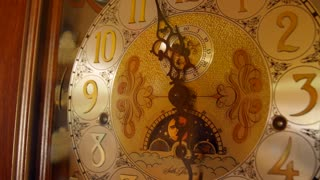 A cool old grandfather clock face in the living room