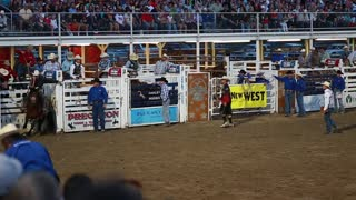 a cowboy bronc ride at rodeo slow motion