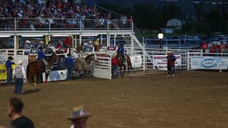 a cowboy saddle bronc ride in rodeo slow motion