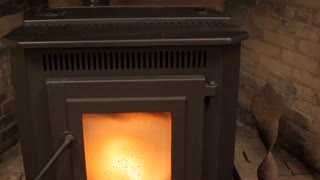 A Dolly Shot Of A Pellet Stove Heating A Room