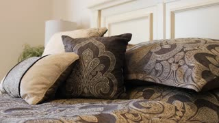 A Dolly Shot Of Beautiful Large Bed With Pillows