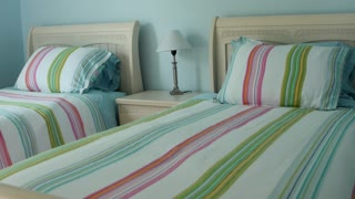 A dolly shot of beautiful modern bedroom and beds