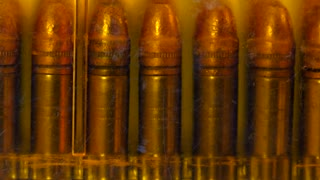 A Dolly shot of bullets in a case