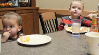 A Dolly Shot Of Cute Little Boys Eating A Continental Breakfast