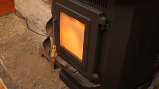 A Dolly Shot Of Pellet Stove Heating A Room In Winter