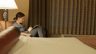 A Dolly Shot Of Woman Looking At Her Smart Phone In A Hotel Sofa