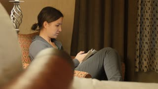 A Dolly Shot Of Woman Talking On Her Smart Phone In A Hotel Sofa