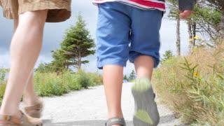 A family hiking the skyline trail in Cape Breton Nova Scotia Canada