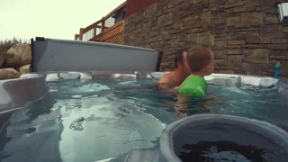 A father with his boys in hot tub