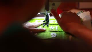 a female using a sewing machine to make advent calendar