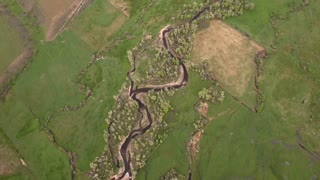 A gorgeous aerial shot above the river in green springtime