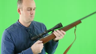 A green screen shot of a shooter with a 270 rifle