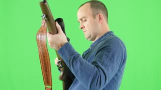 A green screen shot of a shooter with his 270 rifle