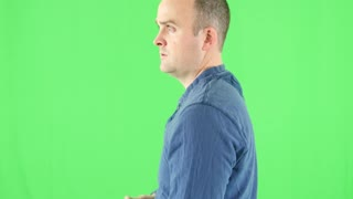 A green screen shot of a shooter with his rifle at camera