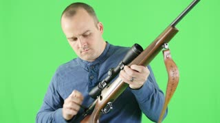 A green screen shot of shooter with a 270 rifle