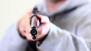 a gunman holding a rifle
