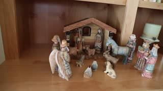 A hand carved wood Nativity creche