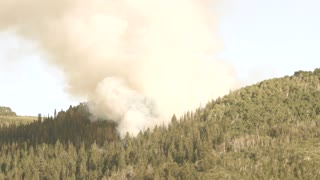 A huge mountain wildfire and smoke