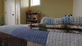 A jib shot of inside a boys bedroom