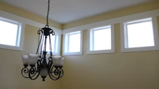 A large chandelier in a new home