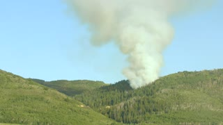 A large mountain wildfire and smoke