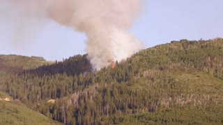 A large mountain wildfire burning